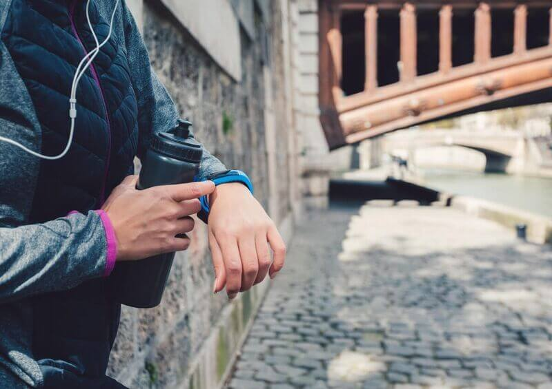 Person checking activity tracker after a run